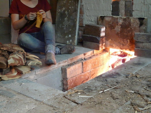 Susannah tending the preheating kiln
